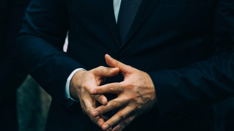 Businessman gesturing with hands