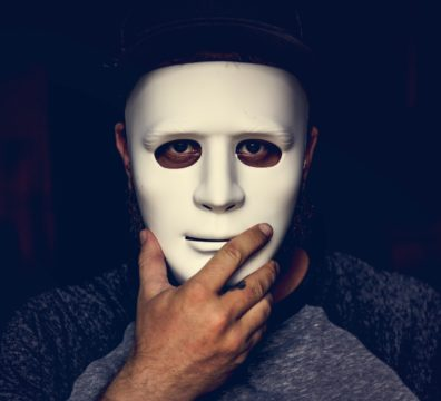 Hand holding mask on a face
